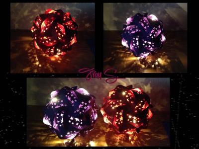 Puzzlelampe lila und rot im Dunkeln
